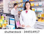 cheerful pharmacist standing at ... | Shutterstock . vector #344514917