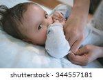 6 month old newborn mixed race... | Shutterstock . vector #344557181