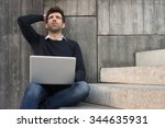 Small photo of worried or alleviated young man with laptop space for text