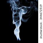 Small photo of Wisp of smoke on black background