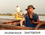 woman on a boat irrawaddy | Shutterstock . vector #344708549