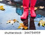 Woman With Pink Rain Boots...