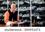 smiling salesman auto parts... | Shutterstock . vector #344951471