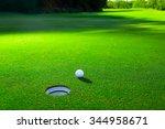 Golf Ball On A Green Lawn