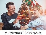 young couple sitting in front... | Shutterstock . vector #344976605