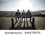 3 Men Unrecognizable Sitting...