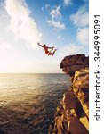 cliff jumping into the ocean at ... | Shutterstock . vector #344995091