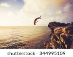 cliff jumping into the ocean at ... | Shutterstock . vector #344995109