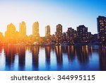 view of city skyline at sunset | Shutterstock . vector #344995115
