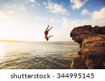 Small photo of Cliff Jumping into the Ocean at Sunset, Outdoor Adventure Lifestyle