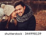 happy couple in warm knitted... | Shutterstock . vector #344998139