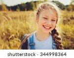 happy child girl in jeans... | Shutterstock . vector #344998364