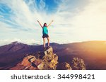 Happy Young Woman Hiker With...
