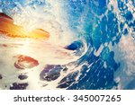 blue ocean wave crashing at... | Shutterstock . vector #345007265