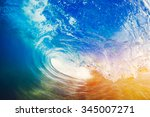 blue ocean wave crashing at... | Shutterstock . vector #345007271