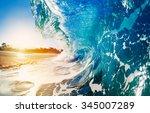 blue ocean wave crashing at... | Shutterstock . vector #345007289