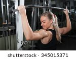 young muscular woman doing... | Shutterstock . vector #345015371