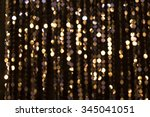 Abstract glittering lights, gold background, a real photo in the blur - stock photo