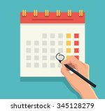 hand with pen mark calendar.... | Shutterstock .eps vector #345128279