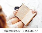 soft photo of woman reading a... | Shutterstock . vector #345168377