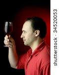 man tasting red wine | Shutterstock . vector #34520053