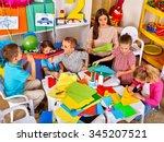 kids with young teacher woman... | Shutterstock . vector #345207521