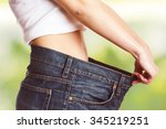 slim waist of young woman with... | Shutterstock . vector #345219251