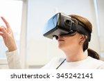 businesswoman using oculus rift ...   Shutterstock . vector #345242141