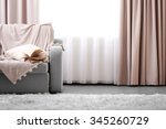 opened book on comfortable sofa ... | Shutterstock . vector #345260729