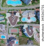 Small photo of ALANIA - AUG 12, 2015: Edifices of My Marine Residence hotel with pools at summer sunny day. Aerial view videoframe