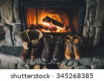 winter boots in front of a... | Shutterstock . vector #345268385
