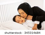 caring muslim mother kissing... | Shutterstock . vector #345314684