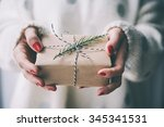 woman's hands hold christmas or ... | Shutterstock . vector #345341531