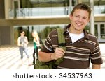 young man at school holding a... | Shutterstock . vector #34537963