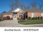 driveway to luxurious brick... | Shutterstock . vector #345395669
