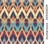 vector colorful seamless ikat... | Shutterstock .eps vector #345434039