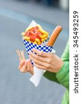 female hands holding paper cone ... | Shutterstock . vector #345493259