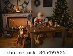 santa claus at home carving... | Shutterstock . vector #345499925