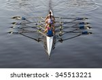 Rowers Paddling In A Beautiful...