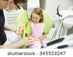 pediatric dentist educating a... | Shutterstock . vector #345523247