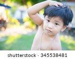 outdoor portrait of a little... | Shutterstock . vector #345538481