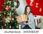 the girl opens a gift | Shutterstock . vector #345548339