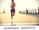runner athlete running at... | Shutterstock . vector #345570779