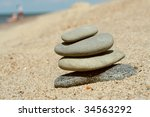 stacked stones at the sand | Shutterstock . vector #34563292