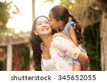 woman giving piggyback ride to... | Shutterstock . vector #345652055