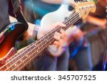 aggressive play guitar on stage | Shutterstock . vector #345707525