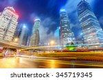 the light trails on the modern... | Shutterstock . vector #345719345