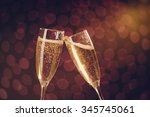 two elegant champagne glasses... | Shutterstock . vector #345745061
