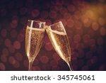 two elegant champagne glasses... | Shutterstock . vector #345745061