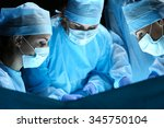 group of surgeons at work... | Shutterstock . vector #345750104